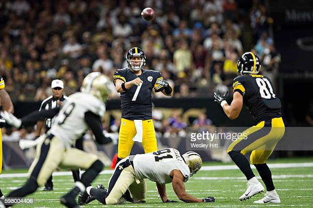 Ben Roethlisberger throws a pass to Jesse James of the Pittsburgh Steelers during a preseason game against the New Orleans Saints at Mercedes-Benz...