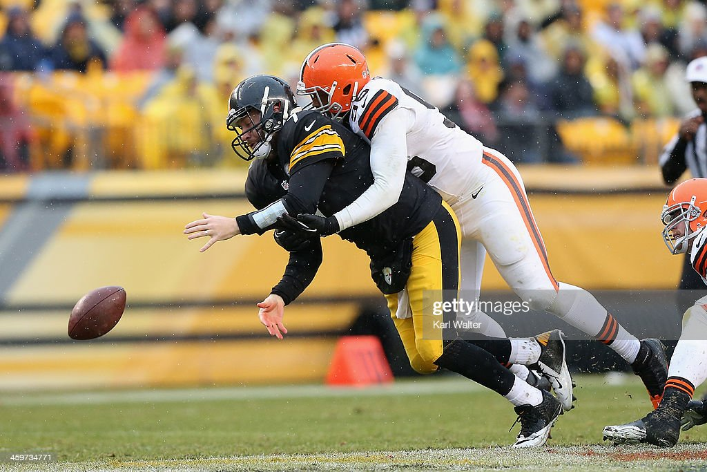 Ben Roethlisburgher #7 of the Pittsburgh Steelers looses the ball as he is hit by Armonty Bryant #95 of the Cleveland Browns during the game at Heinz Field on December 29, 2013 in Pittsburgh, Pennsylvania. The Steelers defeated the Browns 20-7.