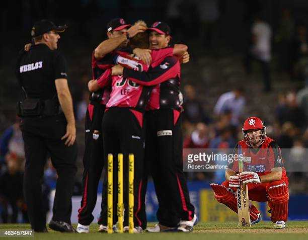 Ben Rohrer of the Renegades looks dejected as the Sixers celebrate their win during the Big Bash League match between the Melbourne Renegades and the...