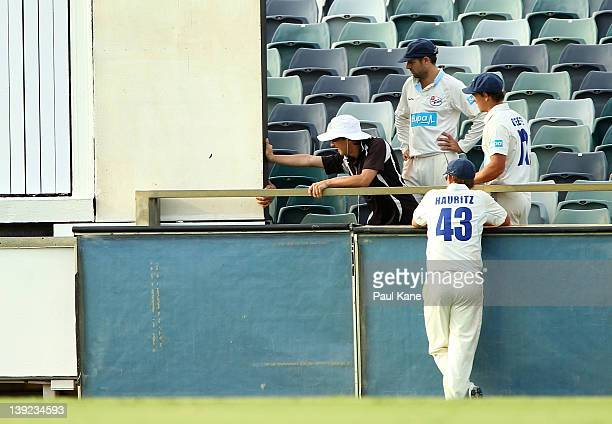 Ben Rohrer Stephen O'Keefe and Nathan Hauritz of the Blues look to assist the sight screen attendant during day two of the Sheffield Shield match...