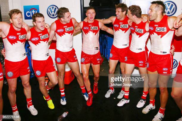 Ben Ronke of the Swans celebrates the win with teammates during the round six AFL match between the Geelong Cats and Sydney Swans at GMHBA Stadium on...