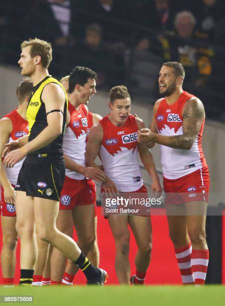 Ben Ronke of the Swans is congratulated by Lance Franklin of the Swans and his teammates after kicking a goal during the round 15 AFL match between...