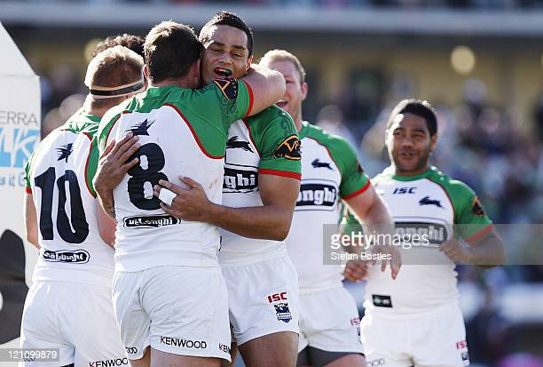 Ben Ross of the Rabbitohs is congratulated after scoring a try during the round 23 NRL match between the Canberra Raiders and the South Sydney...