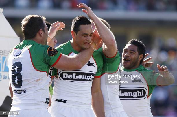 Ben Ross of the Rabbitohs is congratulated by team mates after scoring a try during the round 23 NRL match between the Canberra Raiders and the South...