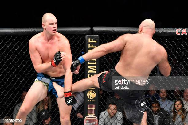 Ben Rothwell accidentally kicks Stefan Struve of Netherlands in the groin in their heavyweight bout during the UFC Fight Night event at Capital One...