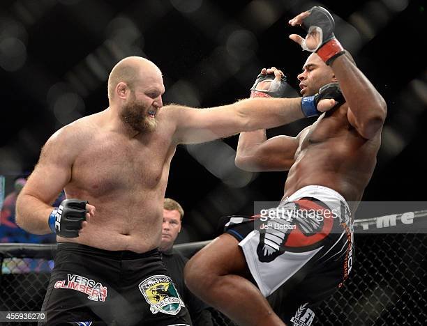 Ben Rothwell creates separation from Alistair Overeem in their heavyweight weight fight during the UFC Fight Night event inside the Grand Theatre at...