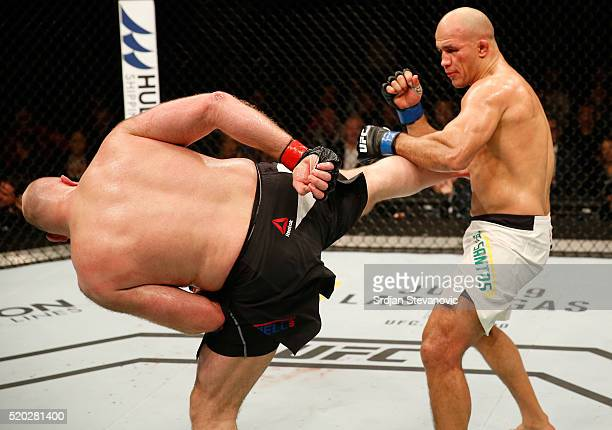 Ben Rothwell kicks Junior Dos Santos in their heavyweight bout during the UFC Fight Night event at the Arena Zagreb on April 10 2016 in Zagreb Croatia