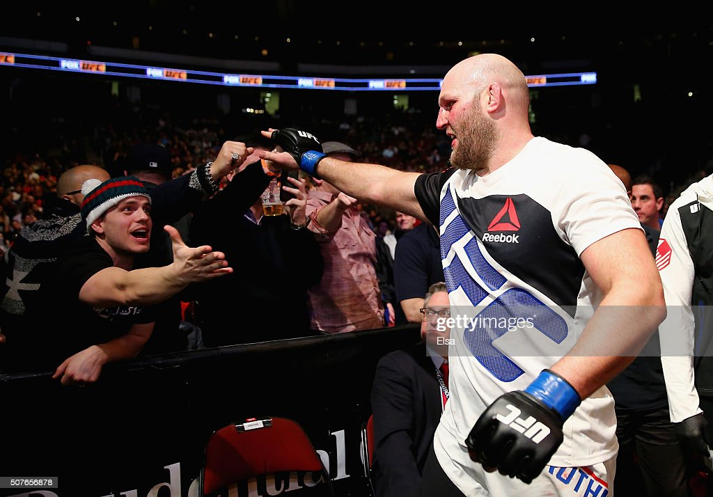 Ben Rothwell of the United States celebrates his second round submission win by guillotine choke against Josh Barnett (not pictured) of the United States as he leaves the Octagon after their heavyweight bout during the UFC Fight Night event at the Prudential Center on January 30, 2016 in Newark, New Jersey.