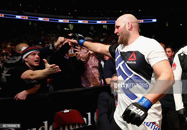 Ben Rothwell of the United States celebrates his second round submission win by guillotine choke against Josh Barnett of the United States as he...