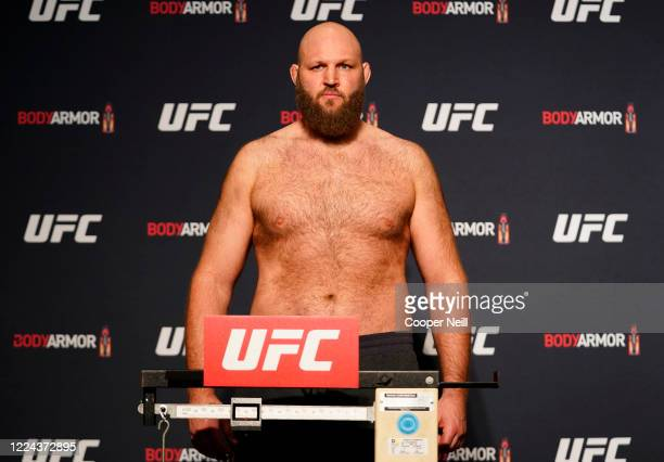 Ben Rothwell poses on the scale during the official UFC Fight Night weighin on May 12 2020 in Jacksonville Florida