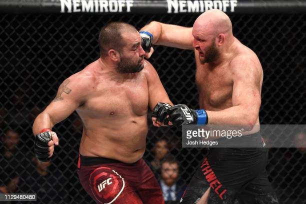 Ben Rothwell punches Blagoy Ivanov of Bulgaria in their heavyweight bout during the UFC Fight Night event at Intrust Bank Arena on March 9 2019 in...