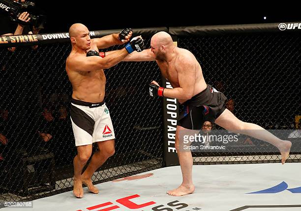 Ben Rothwell punches Junior Dos Santos in their heavyweight bout during the UFC Fight Night event at the Arena Zagreb on April 10 2016 in Zagreb...