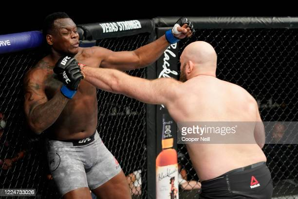Ben Rothwell punches Ovince Saint Preux in their heavyweight bout during the UFC Fight Night Event at VyStar Veterans Memorial Arena on May 13 2020...