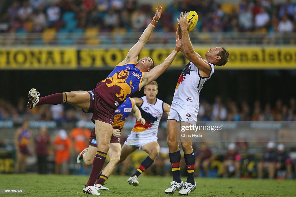 Ben Rutten of the Crows takes a mark over Jonathan Brown of the Lions during the round two AFL match between the Brisbane Lions and the Adelaide Crows at The Gabba on April 6, 2013 in Brisbane, Australia.