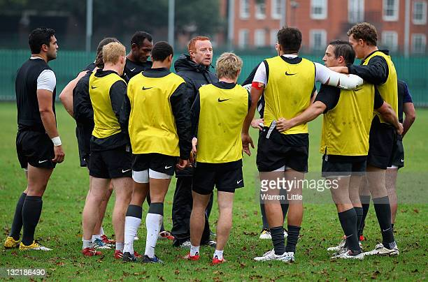 Ben Ryan Head Coach of the England Sevens Team speaks to his team during practice at The Lensbury Club on November 8 2011 in Teddington England