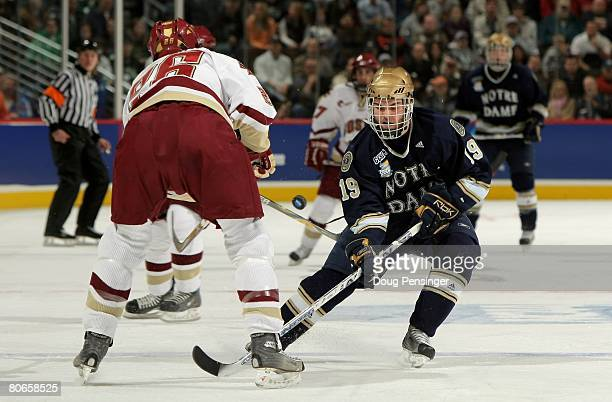 Ben Ryan of the Notre Dame Fighting Irish tries to get the puck past Nick Petrecki of the Boston College Golden Eagles in the 2008 NCAA Frozen Four...