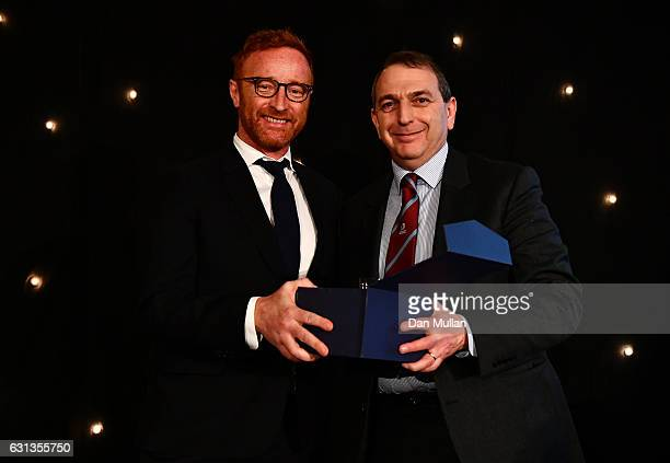 Ben Ryan presents Chris Myers with the Rugby Union Writers' Club Tankard Award during the Rugby Union Writers' Club Annual Dinner Awards at the...