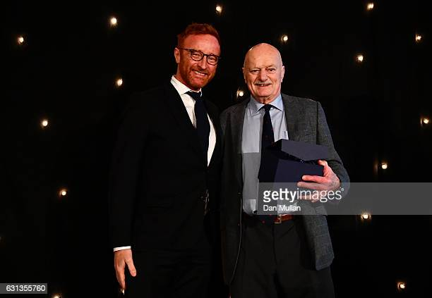 Ben Ryan presents Des Seabrook with the Rugby Union Writers' Club Tankard Award during the Rugby Union Writers' Club Annual Dinner Awards at the...