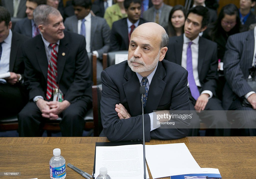 Ben S. Bernanke, chairman of the U.S. Federal Reserve, arrives to a House Financial Services Committee hearing in Washington, D.C., U.S., on Wednesday, Feb. 27, 2013. Bernanke signaled the Fed is prepared to keep buying bonds at its present pace as he dismissed concerns record easing risks sparking inflation or fueling asset price bubbles. Photographer: Andrew Harrer/Bloomberg via Getty Images