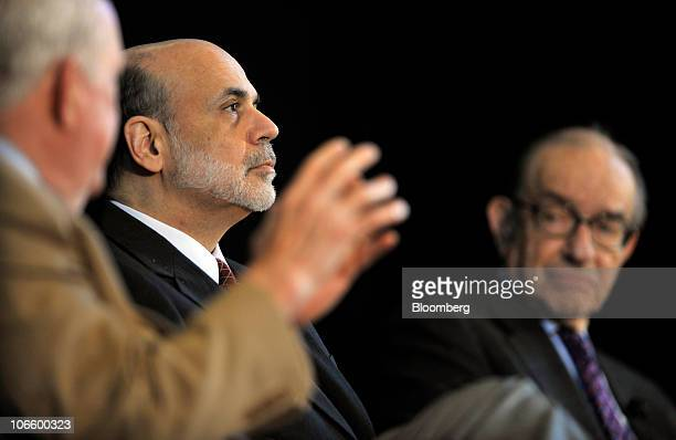 Ben S Bernanke chairman of the US Federal Reserve center and former Fed Chairman Alan Greenspan right listen to E Gerald Corrigan chairman of Goldman...