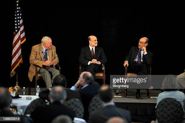 Ben S Bernanke chairman of the US Federal Reserve center listens to former Fed Chairman Alan Greenspan right during a discussion with E Gerald...