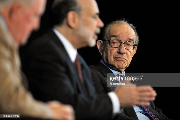 Ben S Bernanke chairman of the US Federal Reserve center speaks during a discussion with former Fed Chairman Alan Greenspan right and E Gerald...