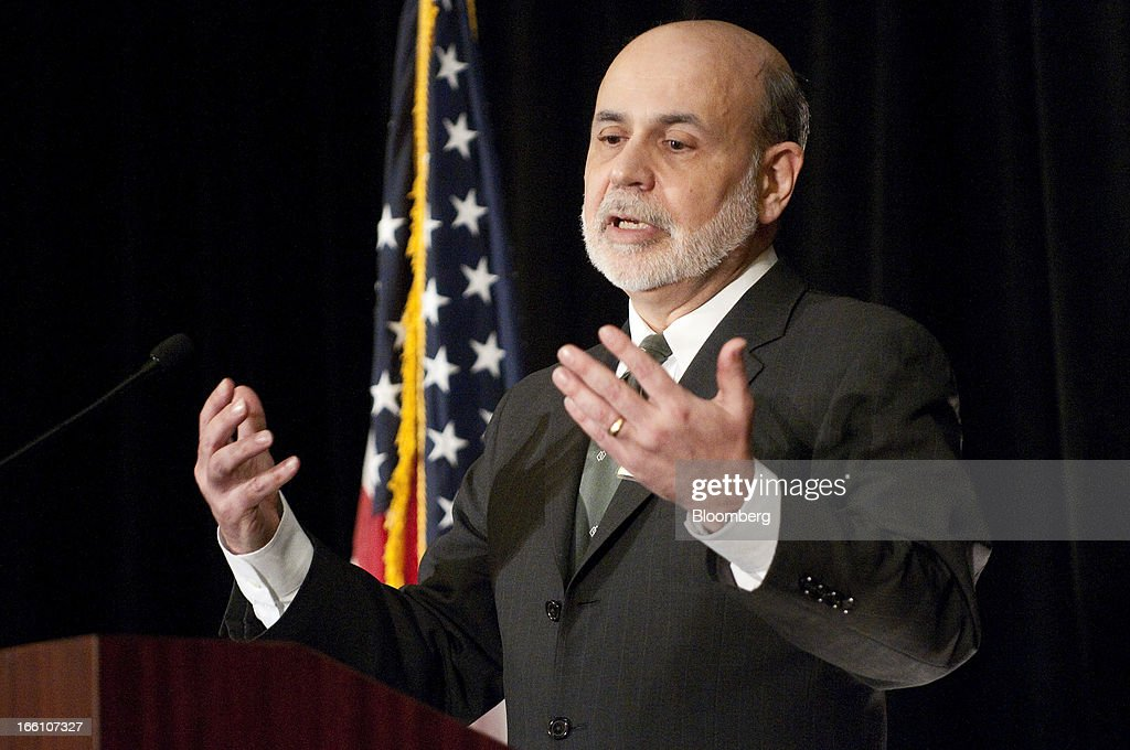 Ben S. Bernanke, chairman of the U.S. Federal Reserve, gestures as he speaks at the Federal Reserve Bank of Atlanta 2013 Financial Markets Conference in Stone Mountain, Georgia, U.S., on Monday, April 8, 2013. Bernanke said the Fed plans to avert strains in the banking system by pushing financial companies to better manage liquidity risk and reduce reliance on wholesale funding. Photographer: Joeff Davis/Bloomberg via Getty Images