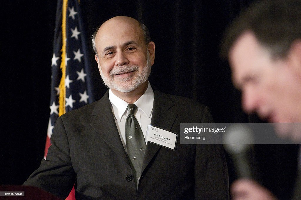 Ben S. Bernanke, chairman of the U.S. Federal Reserve, left, looks on as Dennis P. Lockhart, president and chief executive officer of the Federal Reserve Bank of Atlanta, reads a question during the Federal Reserve Bank of Atlanta 2013 Financial Markets Conference in Stone Mountain, Georgia, U.S., on Monday, April 8, 2013. Bernanke said the Fed plans to avert strains in the banking system by pushing financial companies to better manage liquidity risk and reduce reliance on wholesale funding. Photographer: Joeff Davis/Bloomberg via Getty Images