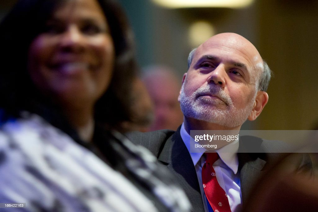 Ben S. Bernanke, chairman of the U.S. Federal Reserve, listens during a community development research conference sponsored by the Federal Reserve in Washington, D.C., U.S., on Friday, April 12, 2013. Bernanke said aiding low-income neighborhoods requires a 'multipronged' approach focusing on education, jobs and health care as well as housing. Photographer: Andrew Harrer/Bloomberg via Getty Images