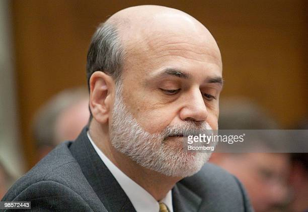 Ben S Bernanke chairman of the US Federal Reserve listens during a House Financial Services Committee hearing on the Lehman Brothers Holdings Inc...