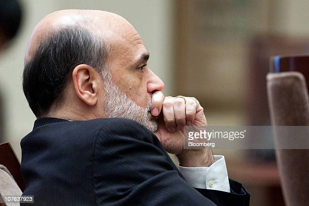 Ben S Bernanke chairman of the US Federal Reserve listens during an open meeting of the Federal Reserve Board in Washington DC US on Thursday Dec 16...