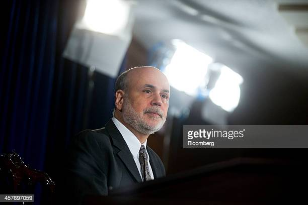 Ben S. Bernanke, chairman of the U.S. Federal Reserve, listens to a question during a news conference following a Federal Open Market Committee...