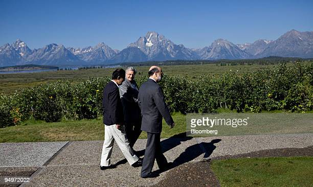 Ben S Bernanke chairman of the US Federal Reserve right walks with JeanClaude Trichet president of the European Central Bank center and Masaaki...