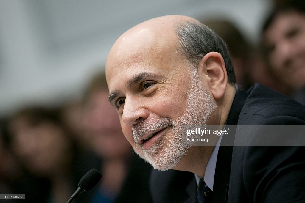 Ben S. Bernanke, chairman of the U.S. Federal Reserve, smiles during a House Financial Services Committee hearing in Washington, D.C., U.S., on Wednesday, Feb. 27, 2013. Bernanke signaled the Fed is prepared to keep buying bonds at its present pace as he dismissed concerns record easing risks sparking inflation or fueling asset price bubbles. Photographer: Andrew Harrer/Bloomberg via Getty Images