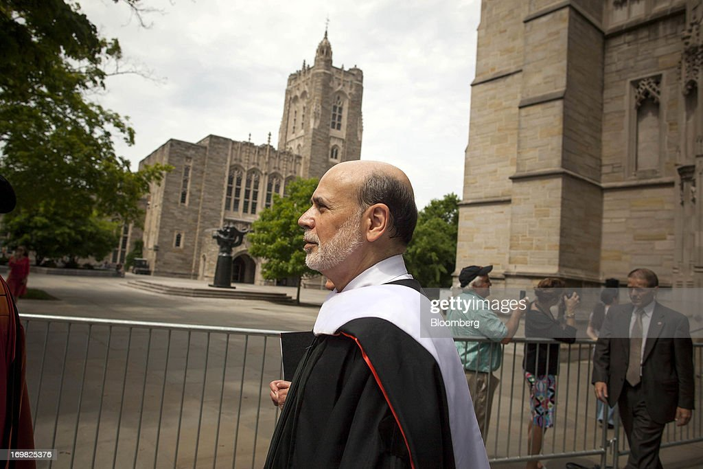 Ben S. Bernanke, chairman of the U.S. Federal Reserve, walks in a processional after delivering the commencement speech to graduates at Princeton University in Princeton, New Jersey, U.S., on Sunday, June 2, 2013. Bernanke, returning to the Princeton University campus where he taught economics for 17 years, offered graduating seniors often humorous advice on subjects ranging from love and success to money and politics in a speech that quoted St. Luke, Lily Tomlin and Forrest Gump. Photographer: Michael Nagle/Bloomberg via Getty Images