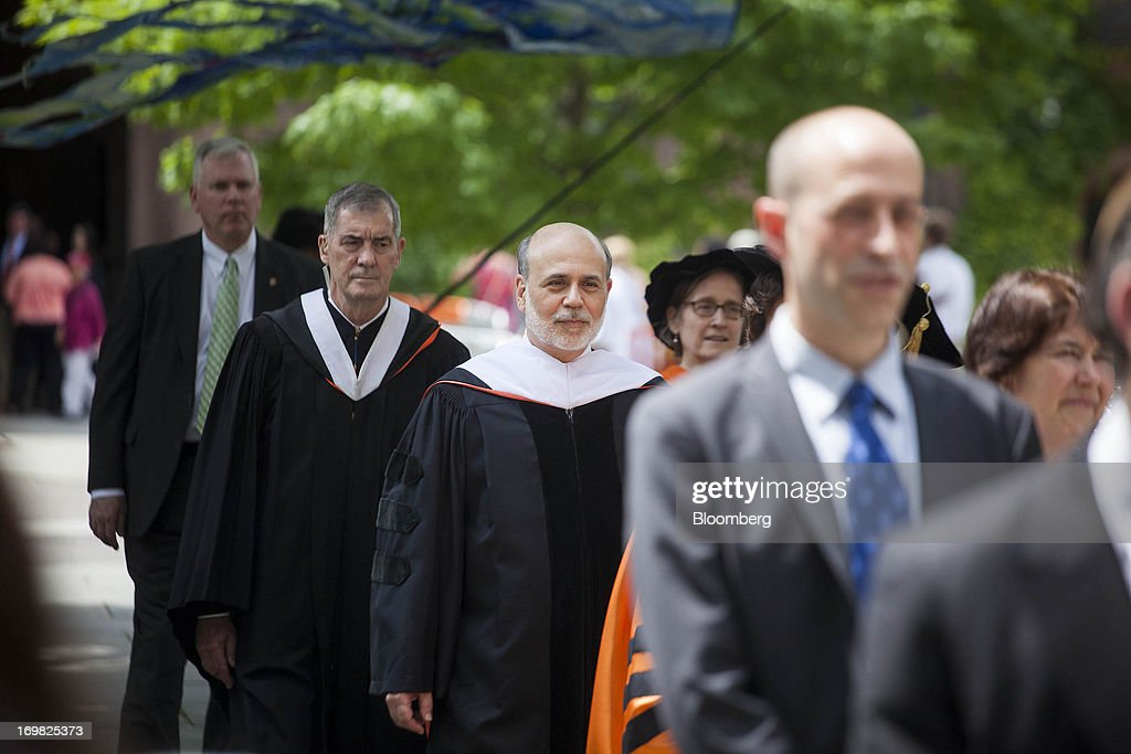 Ben S. Bernanke, chairman of the U.S. Federal Reserve, walks in a processional to deliver the commencement speech to graduates at Princeton University in Princeton, New Jersey, U.S., on Sunday, June 2, 2013. Bernanke, returning to the Princeton University campus where he taught economics for 17 years, offered graduating seniors often humorous advice on subjects ranging from love and success to money and politics in a speech that quoted St. Luke, Lily Tomlin and Forrest Gump. Photographer: Michael Nagle/Bloomberg via Getty Images