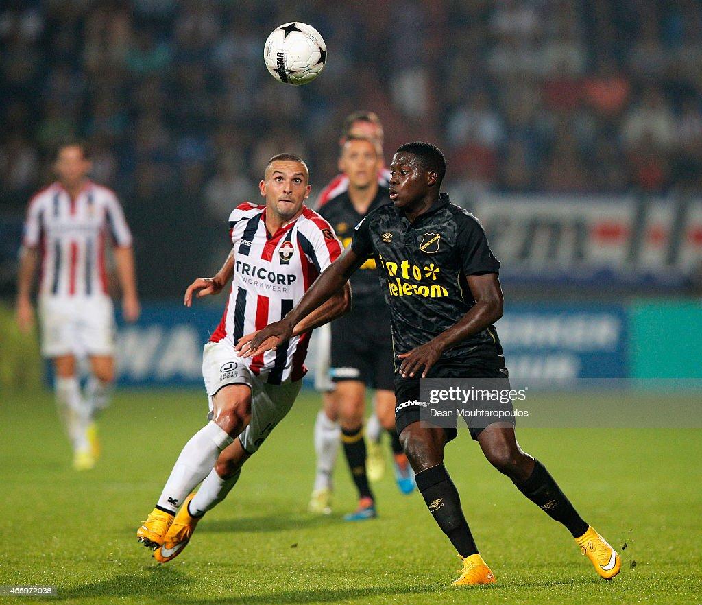 Ben Sahar of Willem II and Isak Ssewankambo of NAC battle for the ball during the Dutch Eredivisie match between Willem II Tilburg and NAC Breda at Koning Willem II Stadium on September 19, 2014 in Tilburg, Netherlands.