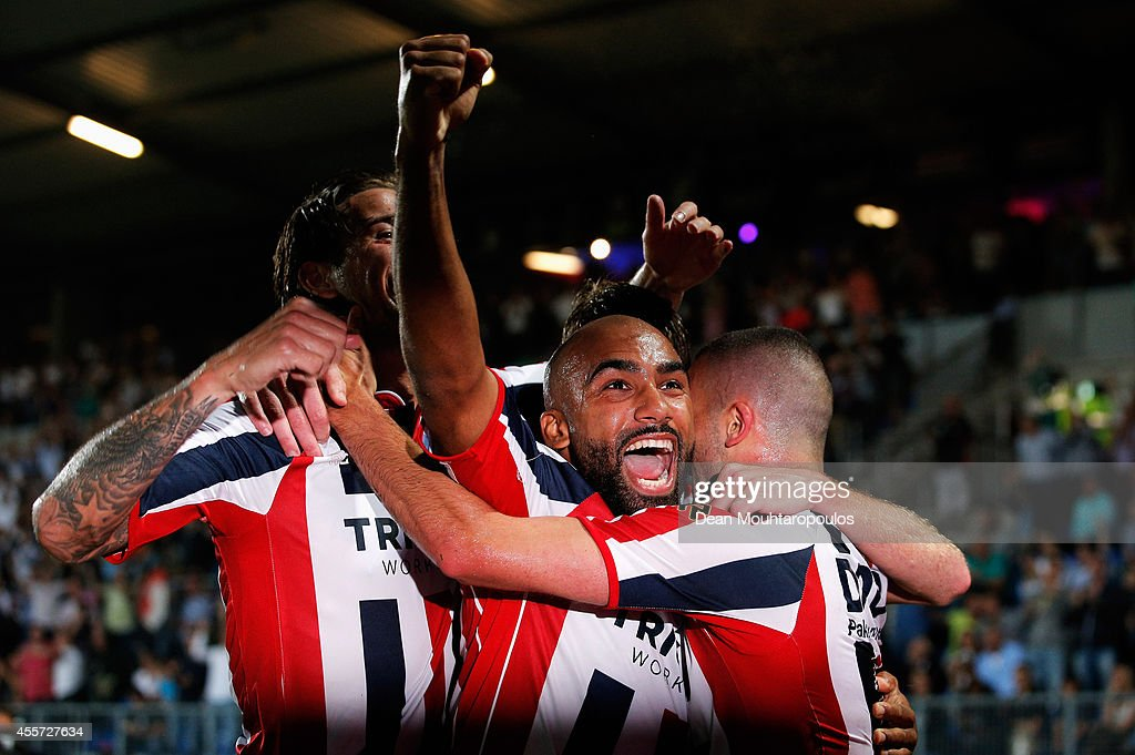 Ben Sahar (R) of Willem II celebrates scoring the first goal of the game with team mates Samuel Armenteros (C) during the Dutch Eredivisie match between Willem II Tilburg and NAC Breda at Koning Willem II Stadium on September 19, 2014 in Tilburg, Netherlands.