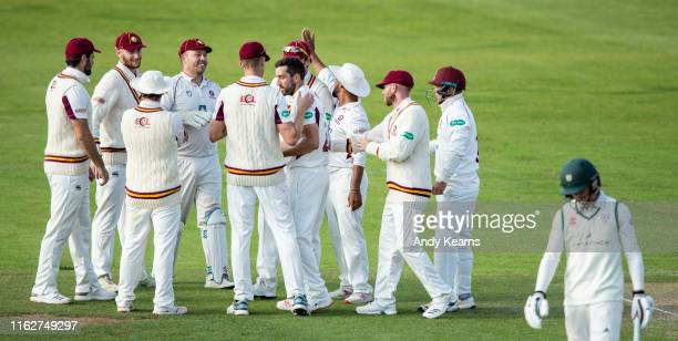 Ben Sanderson of Northamptonshire celebrates with his team mates after taking the wicket of Jack Haynes of Worcestershire during the Specsavers...