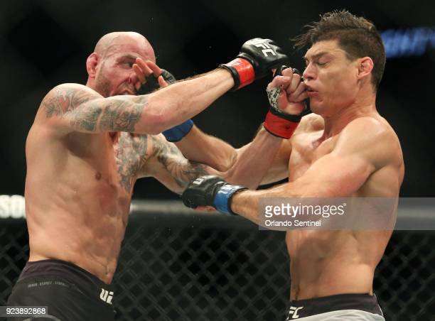 Ben Saunders left and Alan Jouban both land punches to the face during UFC Fight Night at the Amway Center in Orlando Fla on Saturday Feb 24 2018