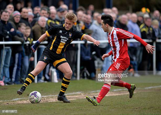 Ben Sayer of Morpeth Town is tackled by Alfie Hilton of Bowers & Pitsea during the FA Vase Semi Final Second Leg match between Morpeth Town AFC and...