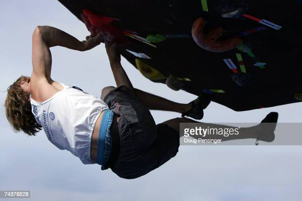 Ben Schmitt of Colorado Springs, Colorado makes his way up a route presented in a problem during the Pro Bouldering Qualifier during The Teva...