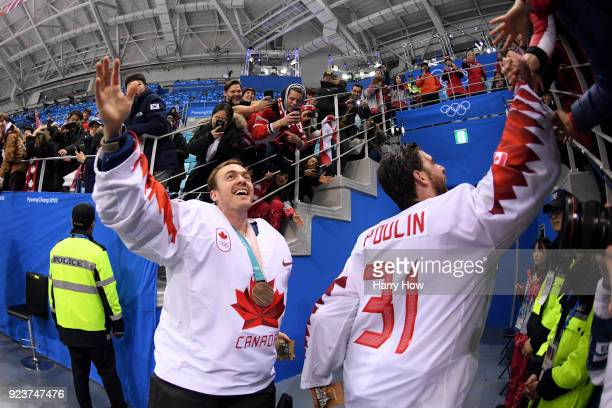 Ben Scrivens and Kevin Poulin of Canada celebrate with fans after defeating Czech Republic 64 during the Men's Bronze Medal Game on day fifteen of...