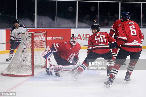 Ben Scrivens of Canada blocks a shot during the match between Team USA and Team Canada at Rod Laver Arena on June 17 2016 in Melbourne Australia