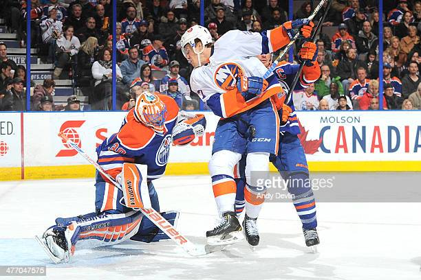 Ben Scrivens of the Edmonton Oilers battles for position against Anders Lee of the New York Islanders on March 6 2014 at Rexall Place in Edmonton...