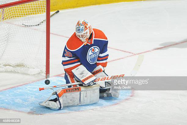 Ben Scrivens of the Edmonton Oilers can't make the stop in overtime in a game against the Ottawa Senators on November 13 2014 at Rexall Place in...