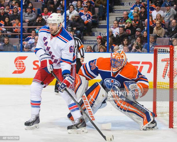 Ben Scrivens of the Edmonton Oilers defends net against Rick Nash of the New York Rangers during an NHL game at Rexall Place on March 30 2014 in...