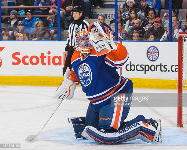 Ben Scrivens of the Edmonton Oilers in action against the Calgary Flames during an NHL game at Rexall Place on March 22 2014 in Edmonton Alberta...