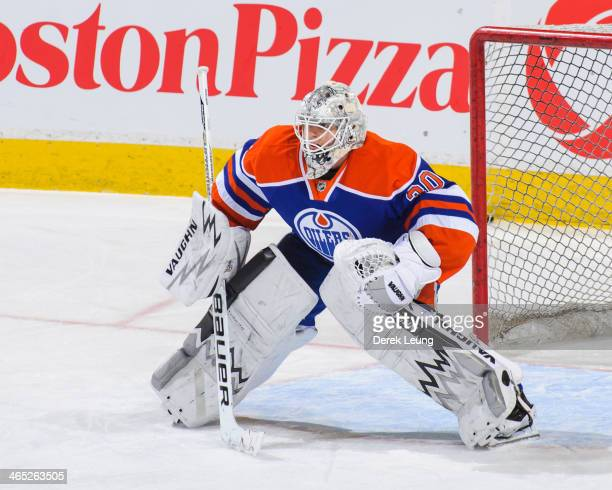 Ben Scrivens of the Edmonton Oilers in action against the Phoenix Coyotes during an NHL game at Rexall Place on January 24 2014 in Edmonton Alberta...