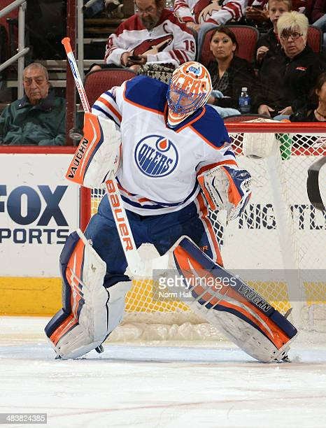 Ben Scrivens of the Edmonton Oilers makes a blocker save against the Phoenix Coyotes at Jobingcom Arena on April 4 2014 in Glendale Arizona